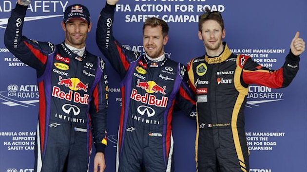 Red Bull Formula One drivers Sebastian Vettel (C) of Germany and Mark Webber of Australia (L) pose with Lotus Formula One driver Romain Grosjean of France after the qualifying session of the Austin F1 Grand Prix at the Circuit of the Americas (Reuters)