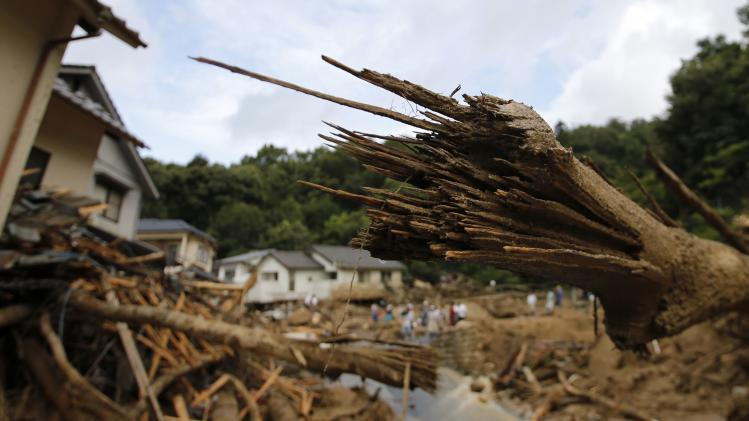 Broken trees are seen at a site where a landslide swept through a residential area at Asaminami ward in Hiroshima