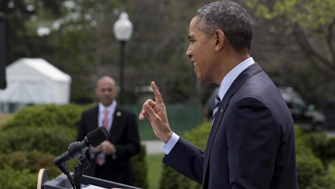 President Barack Obama speaks in the Rose Garden of the White House in Washington, Friday, April 18, 2014, where he presented the Commander-in-Chief's Trophy to the United States Naval Academy football team. The Obama administration is extending indefinitely the amount of time federal agencies have to review the Keystone XL pipeline, the State Department said Friday, likely punting the decision over the controversial oil pipeline past the midterm elections. (AP Photo/Jacquelyn Martin)