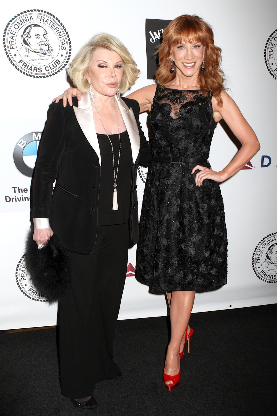 Comedians Joan Rivers and Kathy Griffin pose for photos at the Friars Club Roast of Don Rickles at the Waldorf Astoria on Monday, June 24, 2013 in New York. (Photo by Greg Allen/Invision/AP)