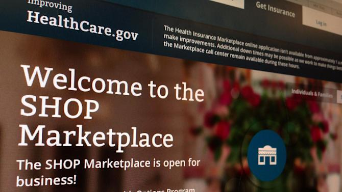 FILE - This Nov. 27, 2013, file photo shows part of the HealthCare.gov website page featuring information about the SHOP Marketplace is photographed in Washington, on Nov. 27, 2013. Trying to limit election-year damage on health care, the Obama administration Monday, Feb. 10, 2014, granted business groups another delay in a much-criticized requirement that larger firms cover their workers or face fines. (AP Photo/Jon Elswick, File)