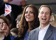 Britain&#39;s Catherine, Duchess of Cambridge watches with Prince William during the Diamond Jubilee concert in front of Buckingham Palace in London