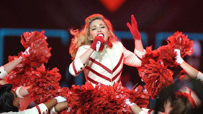 """Madonna performs on the """"MDNA"""" tour at Staples Center on Wednesday Oct. 10, 2012 in Los Angeles.  (Photo by John Shearer/Invision/AP)"""