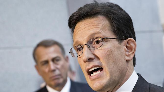 House Majority Leader Eric Cantor, R-Va., with House GOP leaders, speaks with reporters following a Republican strategy session, at the Capitol in Washington, Tuesday, Oct. 15, 2013. At left is Speaker of the House John Boehner, R-Ohio. House GOP leaders Tuesday floated a plan to fellow Republicans to counter an emerging Senate deal to reopen the government and forestall an economy-rattling default on U.S. obligations. But the plan got mixed reviews from the rank and file and it was not clear whether it could pass the chamber. (AP Photo/J. Scott Applewhite)
