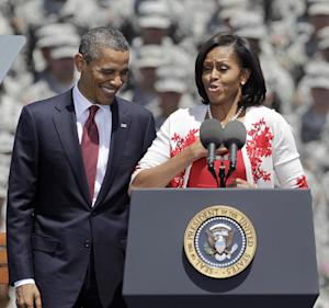 First lady Michelle Obama introduces President Barack Obama at the Fort Stewart Army post, Friday, April 27, 2012, in Fort Stewart, Ga. (AP Photo/David Goldman)