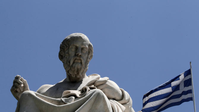 FILE- In this June 5, 2012, file photo, the marble statue of ancient Greek philosopher Plato, stands in front of the Athens Academy, as the Greek flag flies in Athens. Bankers, governments and investors are starting to prepare for Greece to drop the euro currency, a move that could spread turmoil throughout the global financial system. A Greek election on Sunday, June 12, 2012, will go a long way toward determining whether it happens. (AP Photo/Dimitri Messinis, File)