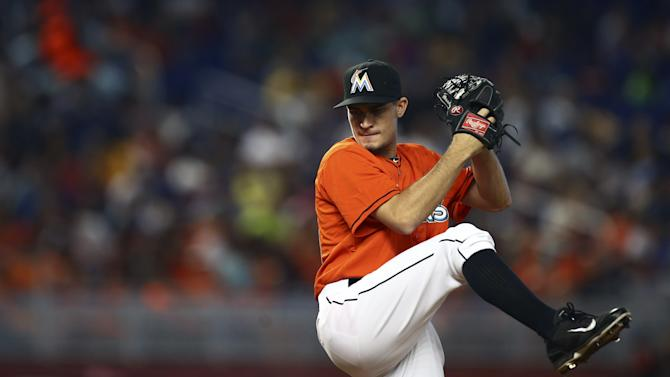 Miami Marlins' relief pitcher Andrew Heaney throws to the Washington Nationals during the seventh inning of a baseball game in Miami, Sunday, Sept. 21, 2014. The Nationals won 2-1. (AP Photo/J Pat Carter)