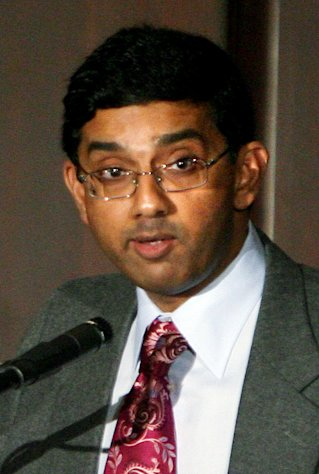 FILE- In this Feb. 1, 2007 file photo, Dinesh D'Souza presents his opening arguments for the debate over the College of William & Mary President Gene Nichol's decision to remove the cross from permanent display from the altar at Wren Chapel, in Williamsburg, Va. The conservative scholar behind a high-grossing documentary that condemns President Barack Obama is under investigation by the evangelical college he leads over a report he took a woman who is not his wife to an event on Christian values. (AP Photo/Daily Press, Heather S. Hughes)