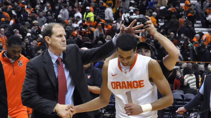 Syracuse assistant coach Mike Hopkins congratulates Michael Carter-Williams after Syracuse defeated Cincinnati 57-55 in an NCAA college basketball game in Syracuse, N.Y., Monday, Jan. 21, 2013. (AP Photo/Kevin Rivoli)