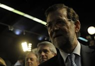 Spanish Prime Minister Mariano Rajoy arrives at a Popular Party&#39;s campaign meeting in Vigo, northwestern Spain, on October 19. Rajoy&#39;s right-leaning party on Sunday retained power in his home region of Galicia despite recession and biting austerity measures, official results showed