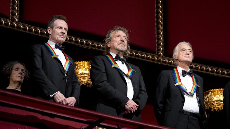 Rock band Led Zeppelin, from left, keyboardist/bassist John Paul Jones, singer Robert Plant, guitarist Jimmy Page, stand as the Star Spangled Banner is played during the Kennedy Center Honors Gala at the Kennedy Center in Washington, Sunday, Dec. 2, 2012. While Led Zeppelin is being honored as a band, surviving members Jones, Page, and Plant, each received the Kennedy Center Honors. (AP Photo/Manuel Balce Ceneta)
