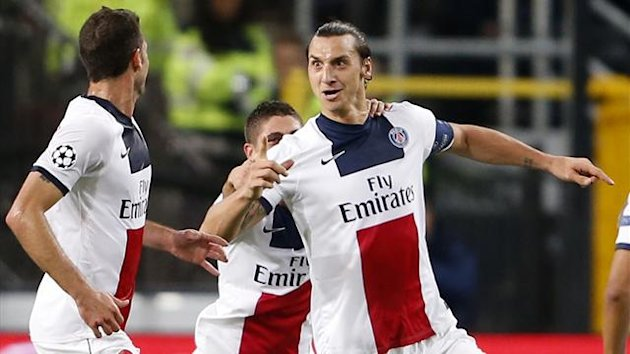 Paris Saint-Germain's Zlatan Ibrahimovic (R) celebrates after scoring against Anderlecht during their Champions League soccer match at Constant Vanden Stock stadium in Brussels October 23, 2013 (Reuters)