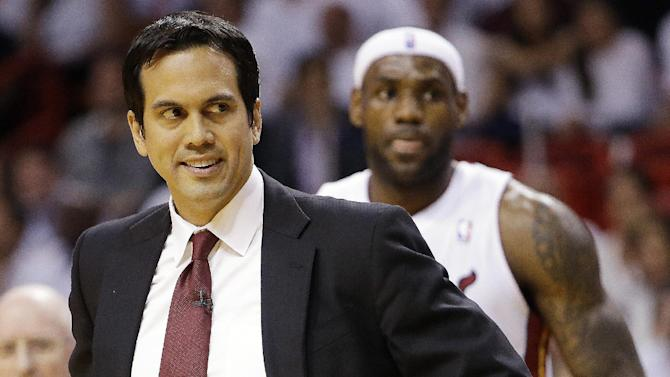 Miami Heat head coach Erik Spoelstra and Miami Heat small forward LeBron James (6) move on the court during the first half of Game 7 in their NBA basketball Eastern Conference finals playoff series against the Indiana Pacers, Monday, June 3, 2013 in Miami. (AP Photo/Lynne Sladky)