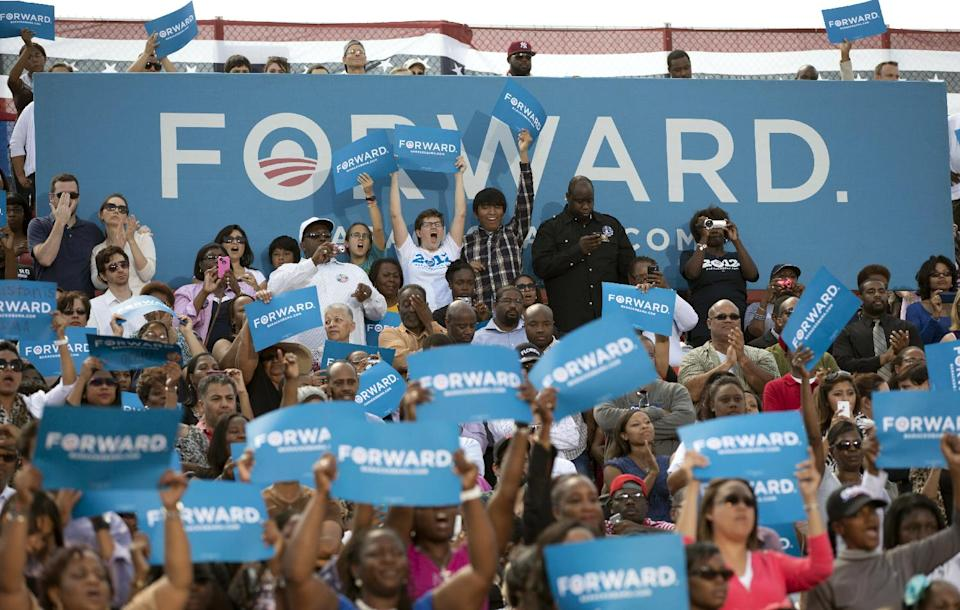 People cheer as President Barack Obama speaks at a campaign event at  G. Richard Pfitzner Stadium, Friday, Sept. 21, 2012, in Woodbridge, Va. (AP Photo/Carolyn Kaster)
