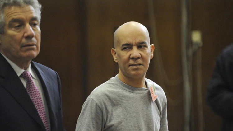 FILE - In this Nov. 15, 2012 file photo, Pedro Hernandez, right, appears in Manhattan criminal court with his attorney Harvey Fishbein, in New York. Hernandez, 51, was scheduled to appear in court Wednesday, Dec. 12, 2012, for an arraignment in the death of Etan Patz, who disappeared on his way to a school bus stop more than three decades ago. (AP Photo/Louis Lanzano, Pool, File)