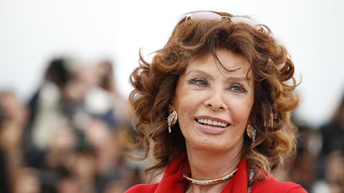 """FILE - This May 21, 2014 file photo shows actress Sophia Loren during a photo call for """"Human Voice,"""" (Voce Umana) at the 67th international film festival, Cannes, southern France. Loren has a deal with Atria Books for the memoir, """"Yesterday, Today and Tomorrow: My Life as a Fairy Tale."""" The publisher announced Thursday, June 26, that the book is scheduled for December 2. Loren, 79, is expected to write about her rise from poverty during World War II to international stardom, sharing her thoughts on Cary Grant, Richard Burton and her husband, Carlo Ponti, among others. (AP Photo/Alastair Grant, File)"""