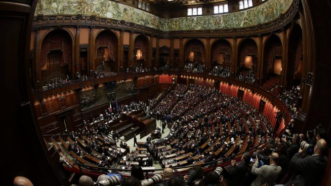 Italian lawmakers attend the first session to elect the Italian Parliament Lower Chamber President,  in Rome, Friday, March 15, 2013.  Italy's newly elected Parliament was heading toward political gridlock as it meets for the first time after inconclusive elections gave no party a clear victory. Investors will keep a close eye on the inaugural session Friday when both chambers will vote for leaders. Only then can Italy's president open talks on forming a government, expected next week. (AP Photo/Gregorio Borgia)