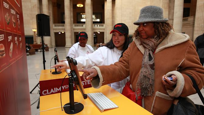 Consumer experiences Wendy's ClaimYourTaste.com at Union Station, on Tuesday, Jan. 15, 2013 in Chicago. (Photo by Barry Brecheisen/Invision for Wendy's/AP Images)