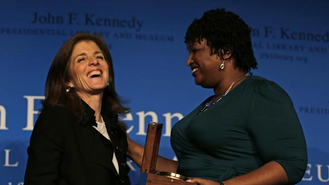 Caroline Kennedy, daughter of the late President John F. Kennedy, poses with Stacey Abrams, right, after presenting the annual Frontier Award at the John F.Kennedy Library in Boston, Monday, Nov. 19, 2012. Abrams, minority leader of Georgia's House of Representatives, is the first woman to lead either party in Georgia's General Assembly. (AP Photo/Charles Krupa)