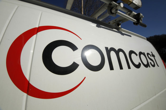 FILE - This Feb. 11, 2011 file photo shows the logo on a Comcast truck in Pittsburgh. Comcast reported on Wednesday Aug. 1, 2012 strong second-quarter earnings from cable operations which overcame returns of the box-office flop &quot;Battleship.&quot; (AP Photo/Gene J. Puskar, file)
