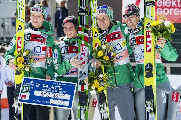 (L-R) Norway's Rune Velta, Anders Fannemel, Bjoern Einar Romoeren, Anders Bardal pose after taking second place of the FIS Ski Flying World Cup Team event in Planica on March 17, 2012.   AFP PHOTO / J
