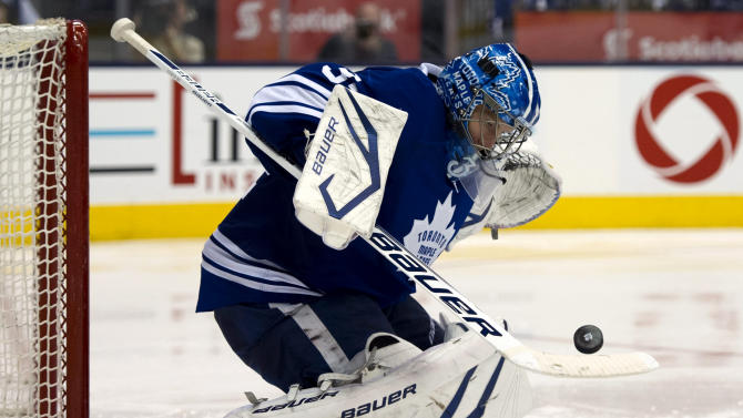 CORRECTS TO GAME 6Toronto Maple Leafs goaltender James Reimer makes a diving save on the Boston Bruins during the third period of Game 6 first-round NHL hockey playoff series in Toronto on Sunday, May 12, 2013. (AP Photo/The Canadian Press, Frank Gunn)