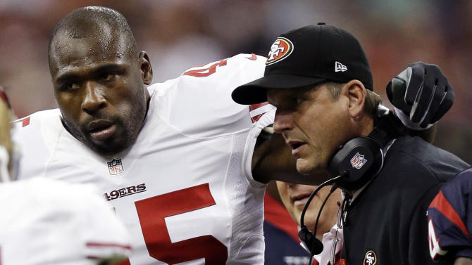 """File - In this Aug. 18, 2012, file photo, San Francisco 49ers' Brandon Jacobs (45) is helped off by head coach Jim Harbaugh in the first quarter of an NFL preseason football game against the Houston Texans in Houston. Jacobs has posted advice on Twitter with a reference to never working """"in a place where you hate your boss so much."""" The hash tag: """"YouLiveAndYouLearn."""" Jacobs had terrible timing with the tweet Thursday, Nov. 15, 2012, considering coach Harbaugh was hospitalized for what the team called a """"minor procedure"""" for an irregular heartbeat. In the locker room soon after his post, Jacobs said people shouldn't """"assume"""" his remarks were football-related, then followed up with more tweets. He made one post saying that """"football is not my life."""" (AP Photo/David J. Phillip, File)"""