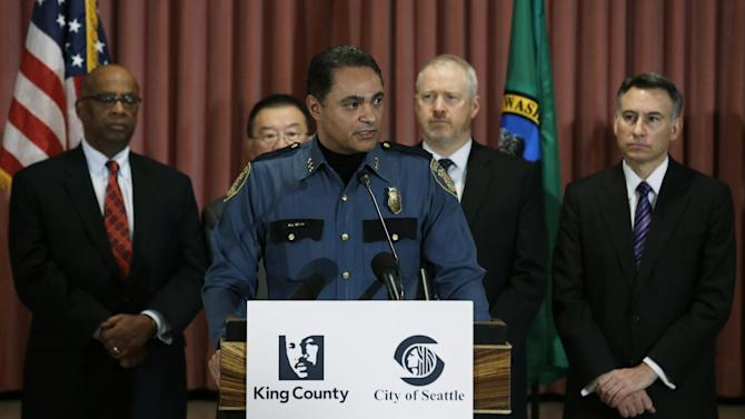 Seattle Deputy Police Chief Nick Metz, center, speaks Tuesday, Jan. 8, 2013,  at a news conference to announce a new gun buyback program that will begin later in January, 2013 in Seattle. Behind him, from left, is former Seattle mayor Norm Rice, Bellevue Mayor Conrad Lee, Seattle Mayor Mike McGinn, and King Co. Executive Dow Constantine. (AP Photo/Ted S. Warren)