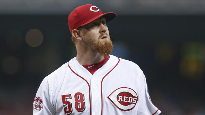 Cincinnati Reds relief pitcher Nate Adcock (58) walks off the mound in the fifth inning of a baseball game against the Milwaukee Brewers, Friday, July 3, 2015, in Cincinnati. The Brewers won 12-1. (AP Photo/John Minchillo)