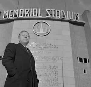 FILE - In this Dec. 11, 1959 file photo, Baltimore Orioles new president Lee MacPhail is photographed in front of the Baltimore Memorial Stadium in Baltimore, Md. Baseball's Hall of Fame says former American League President Lee MacPhail has died at 95. He died Thursday night, Nov. 8, 2012 at his home in Delray Beach, Fla. (AP Photo/File)