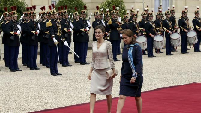 Spain's Queen Letizia and French Minister for Ecology, Sustainable Development and Energy, Segolene RoyaI arrive at the Elysee Palace in Paris