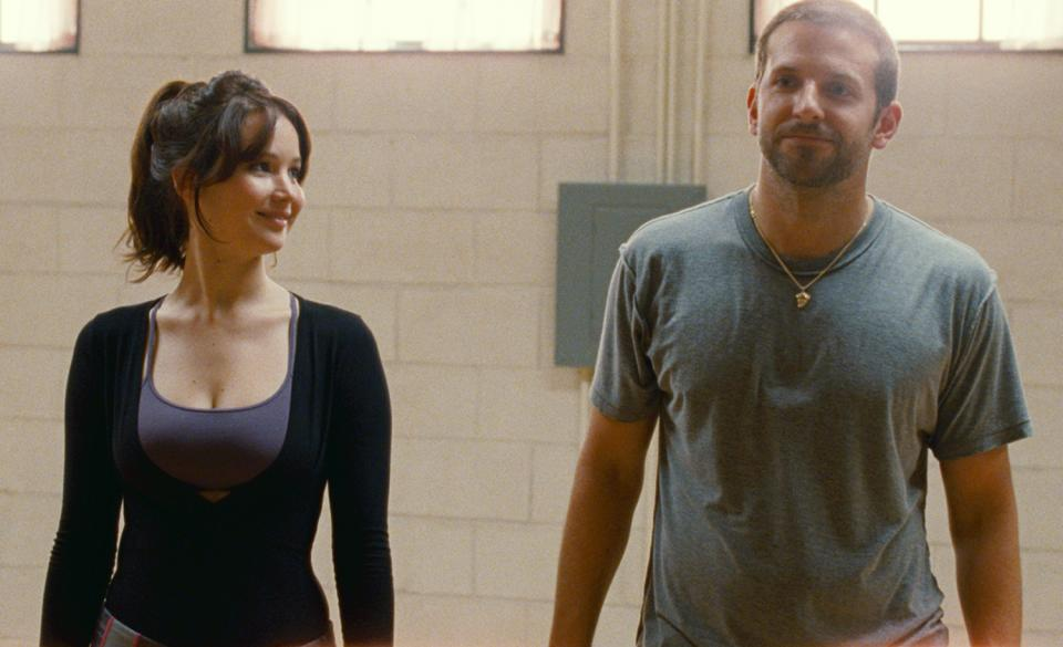 "This film image released by The Weinstein Company shows Jennifer Lawrence, left, and Bradley Cooper in ""Silver Linings Playbook."" (AP Photo/The Weinstein Company, JoJo Whilden)"