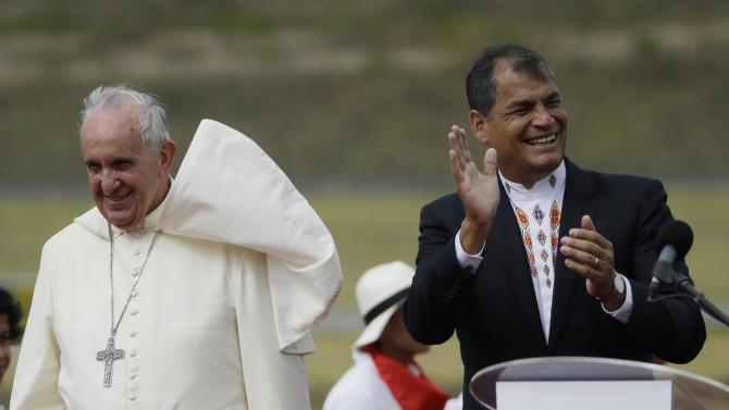 Ecuador's President Rafael Correa, right, greets Pope Francis upon his arrival to the Mariscal Sucre International airport in Quito Sunday July 5, 2015. History's first Latin American pope returns to Spanish-speaking South America for the first time on Sunday to visit Ecuador, Bolivia and Paraguay. (AP Photo/Gregorio Borgia)