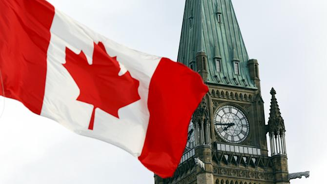 The Canadian flag flies on Parliament Hill in Ottawa