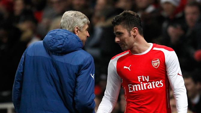 Arsenal''s striker Olivier Giroud (R) shakes hands with team manager Arsene Wenger as he leaves the field after being substituted during an English FA Cup match in London, on February 15, 2015
