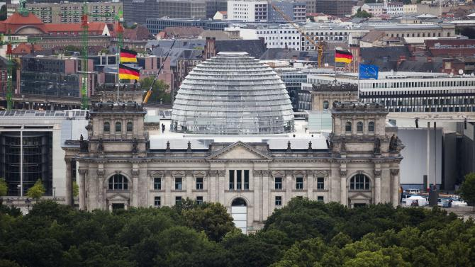 The  Reichstag building, house of German parliament Bundestag in Berlin, Tuesday, June 26, 2012. German parliament will vote on the European Stability Mechanism, ESM, and the EU fiscal compact on Friday, June 29. (AP Photo/Markus Schreiber)