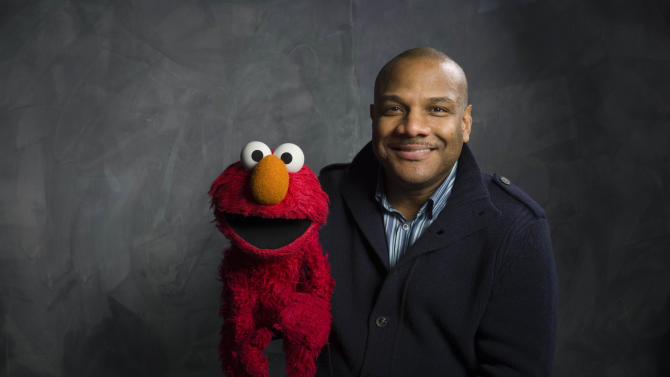 """FILE - This Jan. 24, 2011 file photo shows Elmo and puppeteer Kevin Clash of the film """"Being Elmo"""" poses for a portrait in the Fender Music Lodge during the 2011 Sundance Film Festival in Park City, Utah. Clash who was the puppeteer and voice of Elmo on """"Sesame Street"""" is being sued for the fifth time, accused of sexually abusing an underage youth. In a federal lawsuit filed in New York on Tuesday, April 2, 2013, 25-year-old Kevin Kiadii says he was 16 when he met Kevin Clash during an online chat. (AP Photo/Victoria Will, File)"""