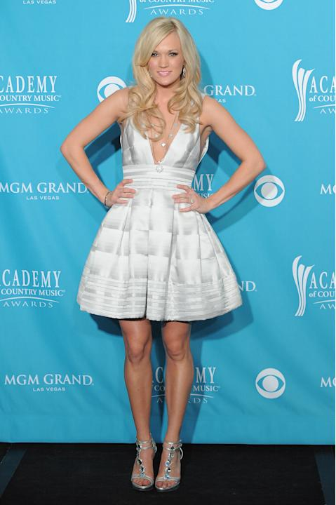 Carrie in a white A-line dress