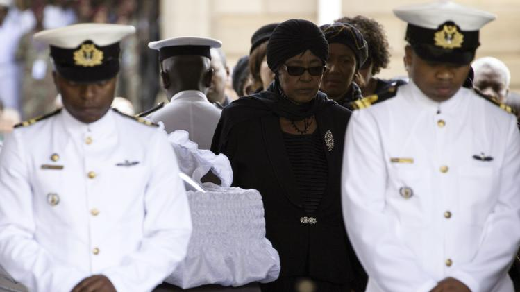 Winnie Mandela, ex-wife of former South African President Nelson Mandela, pays her respects at his coffin as he lies in state at the Union Buildings in Pretoria