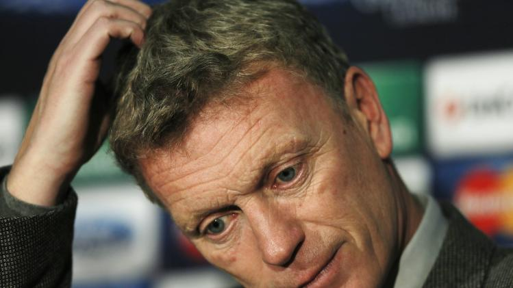 Manchester United's manager Moyes scratches his head during a news conference at Old Trafford in Manchester