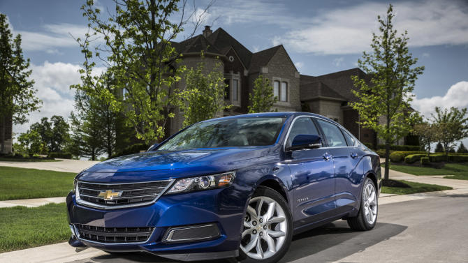 This undated photo made available by General Motors shows the 2014 Chevrolet Impala 2.5L iVLC. The 2014 Chevrolet Impala was the only non-luxury car to earn the highest safety rating in new tests of high-tech crash prevention systems. It earned the top rating even though the government is investigating one driver's report that the automatic braking system went off several times without warning, eventually causing an accident. Insurance Institute spokesman Russ Rader said the group is aware of the investigation but had no issues when it was testing the Impala. (AP Photo/GM)