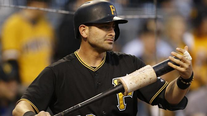 Pittsburgh Pirates' Francisco Cervelli (29) warms up on deck in the baseball game between the Pittsburgh Pirates and the Chicago Cubs on Monday, April 20, 2015, in Pittsburgh.  (AP Photo/Keith Srakocic)