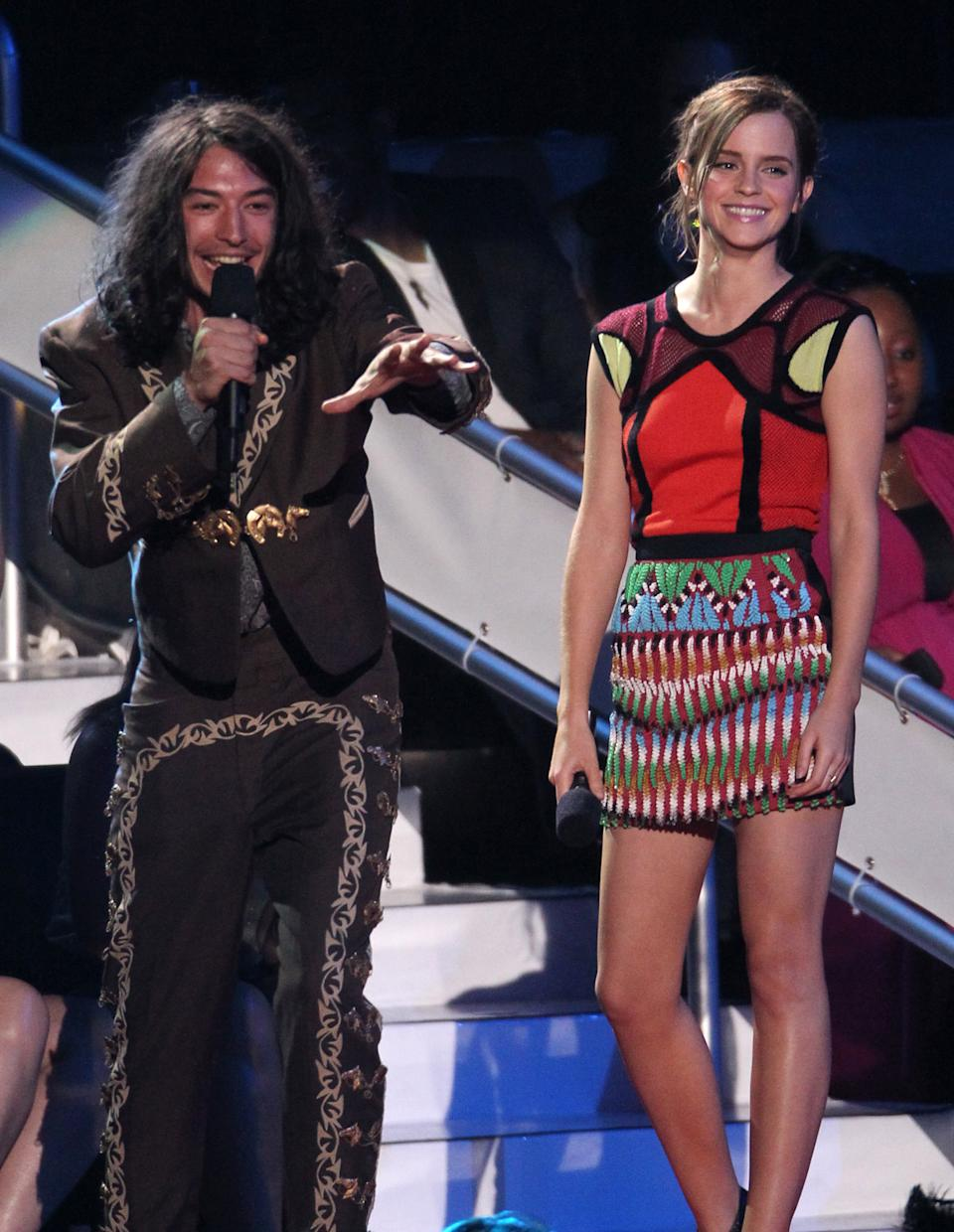 Ezra Miller, left, and Emma Watson speak onstage at the MTV Video Music Awards on Thursday, Sept. 6, 2012, in Los Angeles. (Photo by Matt Sayles/Invision/AP)