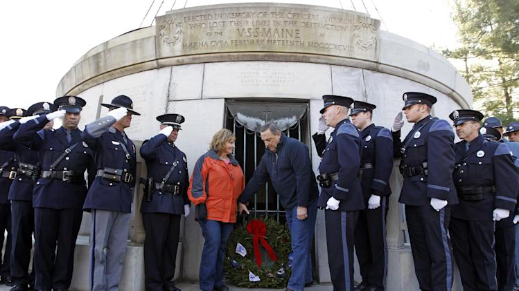 Maine Gov. Paul LePage and his wife Ann lay a wreath during a ceremony at USS Maine Mast during holiday wreaths laying at Arlington National Cemetery in Arlington, Va. on Saturday, Dec. 15, 2012, during Wreaths Across America Day. Wreaths Across America was started in 1992 at Arlington National Cemetery by Maine businessman Morrill Worcester and has expanded to hundreds of veterans' cemeteries and other locations in all 50 states and beyond.  (AP Photo/Jose Luis Magana)
