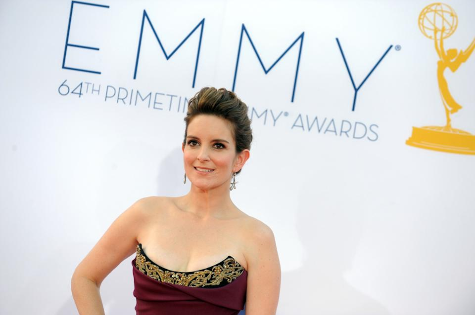 Actress Tina Fey arrives at the 64th Primetime Emmy Awards at the Nokia Theatre on Sunday, Sept. 23, 2012, in Los Angeles.  (Photo by Jordan Strauss/Invision/AP)