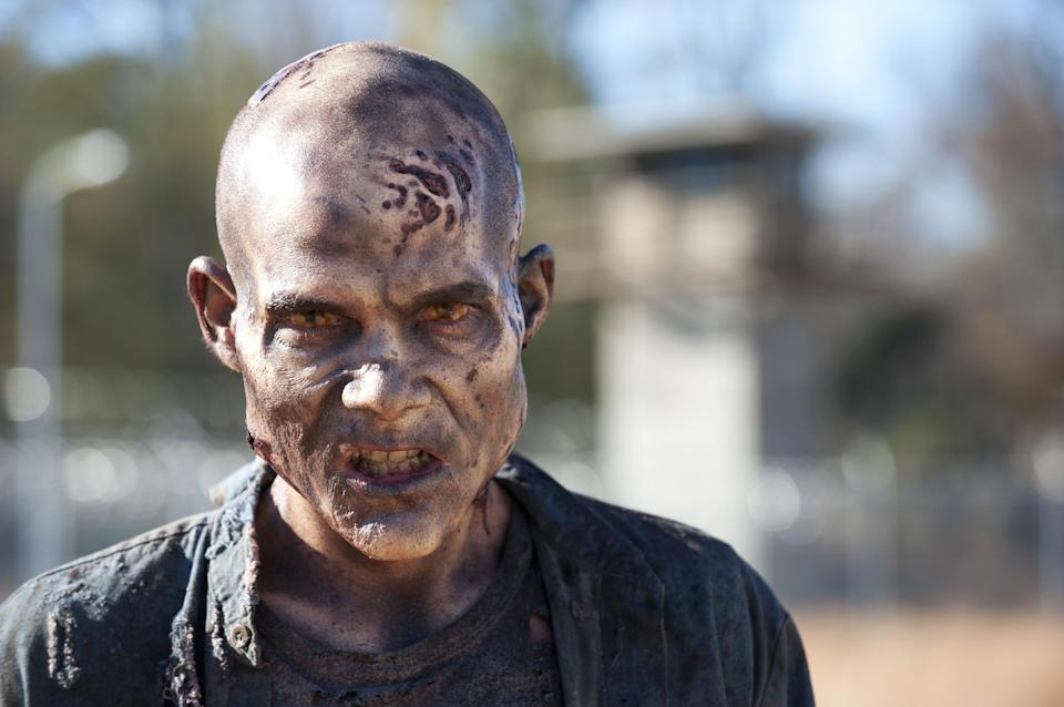 "This publicity photo released by AMC shows a walker (zombie) in Episode 16, ""Welcome to the Tombs"" from the TV series, ""The Walking Dead,"" Season 3. (AP Photo/AMC, Gene Page)"
