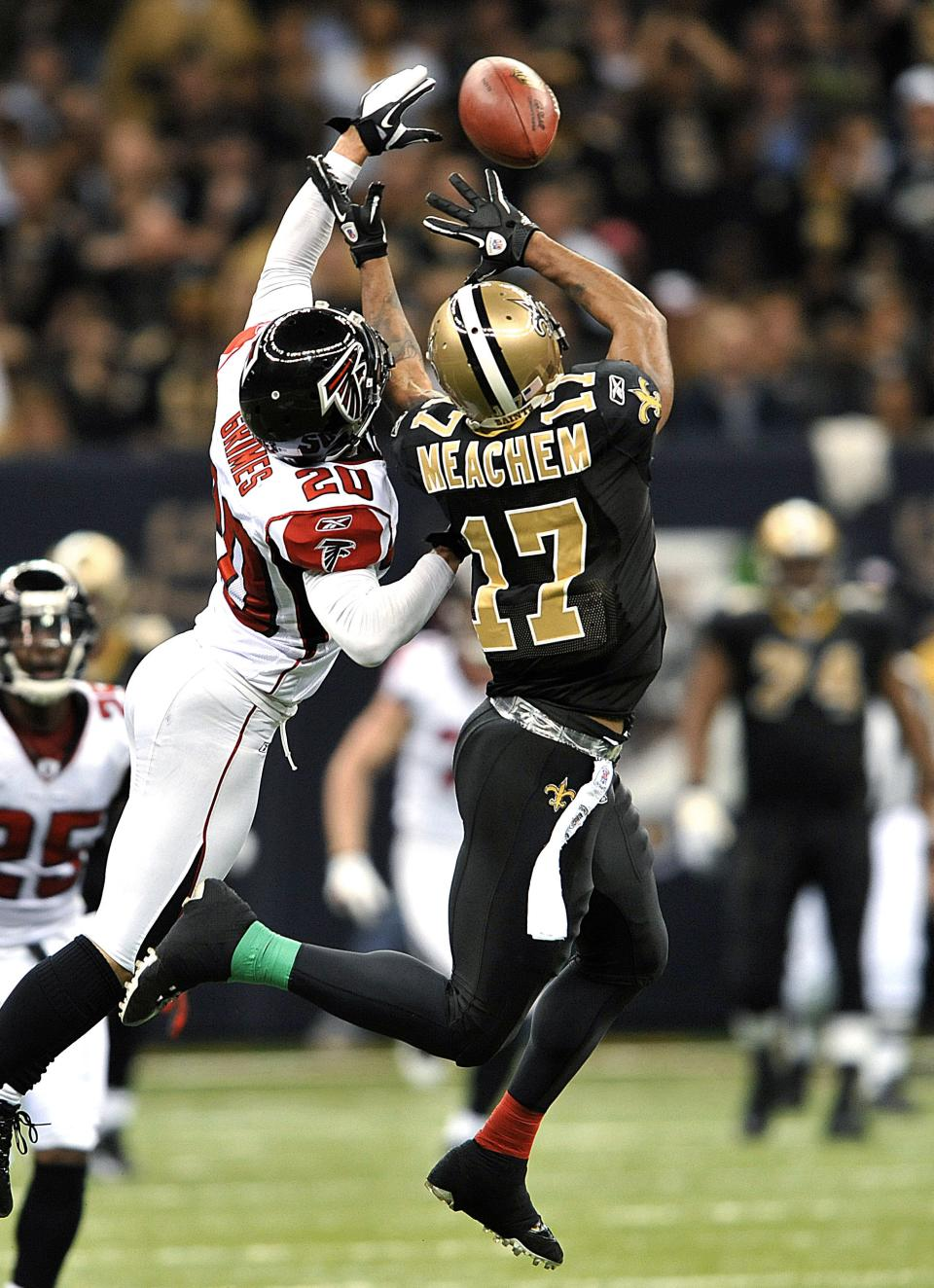 Atlanta Falcons cornerback Brent Grimes (20) tries to break up a pass intended for New Orleans Saints wide receiver Robert Meachem (17) during an NFL football game in New Orleans, Monday, Dec. 26, 2011. (AP Photo/Bill Feig)