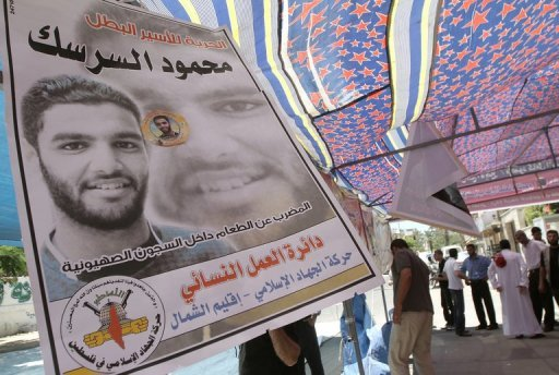 A poster of Mahmud Sarsak hangs at a protest tent in solidarity with Palestinian prisoners held in Israeli jails outside the International Committee of the Red Cross (ICRC) offices in Gaza City on June 8. Israel's Prisons Service said Sarsak -- who has been on hunger strike for more than 80 days -- had ended his protest, but Palestinian sources have denied the claim