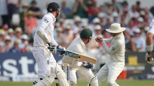 Stuart Broad, left, remained at his crease despite edging to Michael Clarke at slip