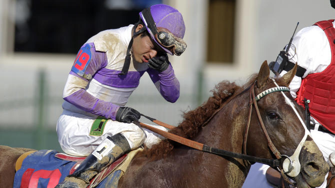 Jockey Mario Gutierrez reacts ridding I'll Have Another to victory in the 138th Kentucky Derby horse race at Churchill Downs Saturday, May 5, 2012, in Louisville, Ky. (AP Photo/Darron Cummings)